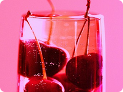 Pink Cherries in Glass of Chardonnay