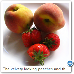The velvety looking peaches and the shiny strawberries.